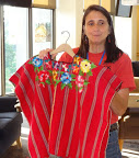 Phyllis Terwiliger displays colorful clothing from Latin America.